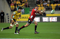 Bryn Hall passes during the Super Rugby match between the Hurricanes and Crusaders at Westpac Stadium in Wellington, New Zealand on Saturday, 10 March 2018. Photo: Dave Lintott / lintottphoto.co.nz