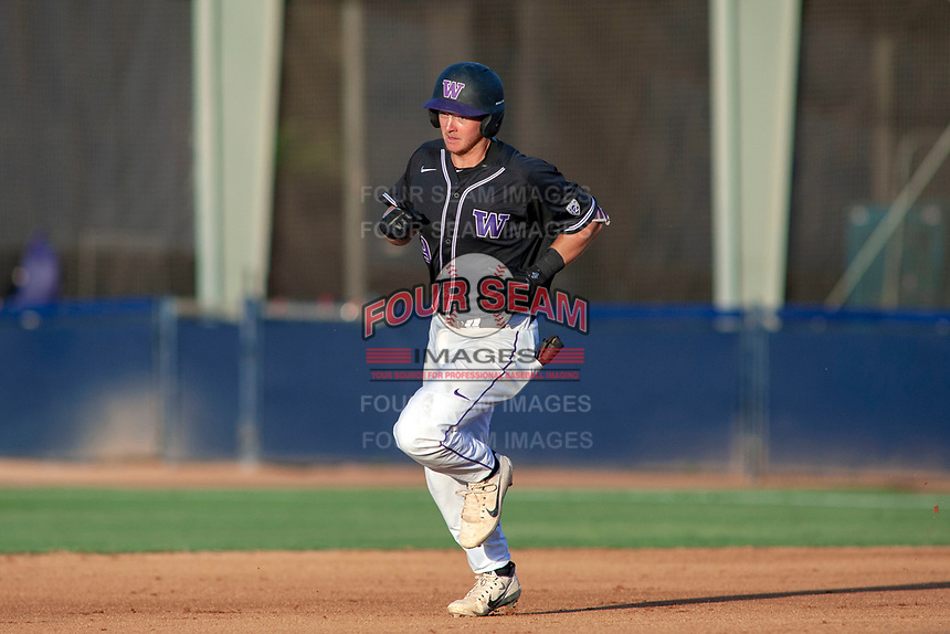 University of Washington Huskies Willie MacIver (9) rounds the bases after hitting a home run against the Cal State Fullerton Titans at Goodwin Field on June 10, 2018 in Fullerton, California. The Huskies defeated the Titans 6-5. (Donn Parris/Four Seam Images)