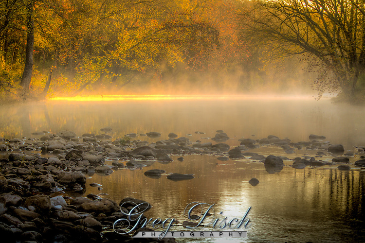 The sun breaking through the fog at the Erbie Ford on the Buffalo National River in Arkansas.