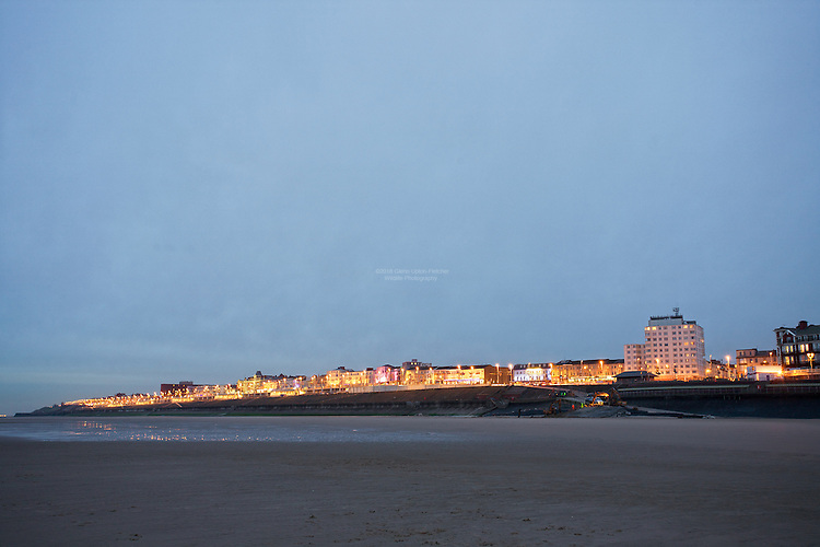 Blackpool North Shore Mile of lIghts, seen from the Beach near North Pier. Construction workers taking advantage of the low tide for the regeneration of Blackpool seafront.