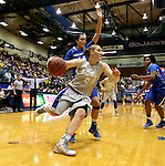 BROOKINGS, SD - NOVEMBER 18:  Chynna Stevens #0 from South Dakota State University drives to the basket past Sydney Lamberty #14 from Creighton in the first half of their game Tuesday night at Frost Arena in Brookings. (Photo by Dave Eggen/Inertia)