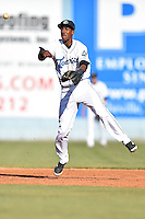 Asheville Tourists shortstop Luis Jean (3) throws to first during game one of a double header against the Hickory Crawdads on April 21, 2015 in Asheville, North Carolina. The Crawdads defeated the Tourists 10-1. (Tony Farlow/Four Seam Images)