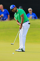 Anirban Lahiri (IND) takes his birdie putt on the 14th green during Thursday's Round 1 of the 145th Open Championship held at Royal Troon Golf Club, Troon, Ayreshire, Scotland. 14th July 2016.<br /> Picture: Eoin Clarke | Golffile<br /> <br /> <br /> All photos usage must carry mandatory copyright credit (&copy; Golffile | Eoin Clarke)