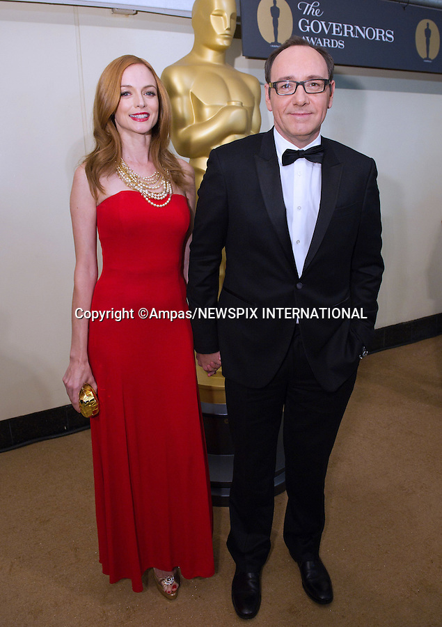 """HEATHER GRAHAM AND KEVIN SPACEY.2010 Governors Awards,Grand Ballroom at Hollywood & Highland,Hollywood, Los Angeles_14/11/2010.Mandatory Photo Credit: ©Harbaugh/Newspix International..**ALL FEES PAYABLE TO: """"NEWSPIX INTERNATIONAL""""**..PHOTO CREDIT MANDATORY!!: NEWSPIX INTERNATIONAL(Failure to credit will incur a surcharge of 100% of reproduction fees)..IMMEDIATE CONFIRMATION OF USAGE REQUIRED:.Newspix International, 31 Chinnery Hill, Bishop's Stortford, ENGLAND CM23 3PS.Tel:+441279 324672  ; Fax: +441279656877.Mobile:  0777568 1153.e-mail: info@newspixinternational.co.uk"""