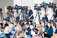 Television cameras stand behind the audience while Democratic presidential candidate and former First Lady and Secretary of State Hillary Rodham Clinton speaks at the Women's Economic Opportunity Summit at Southern New Hampshire University in Hooksett, New Hampshire.