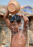 A Rohingya boy bathes in the Jamtoli Refugee Camp near Cox's Bazar, Bangladesh. More than 600,000 Rohingya have fled government-sanctioned violence in Myanmar for safety in Bangladesh.