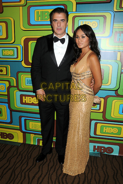 CHRIS NOTH & TARA WILSON.HBO 2011 Post Golden Globe Awards Party held at The Beverly Hilton Hotel, Beverly Hills, California, USA..January 16th, 2011.full length black tuxedo bow tie gold dress cleavage couple .CAP/ADM/BP.©Byron Purvis/AdMedia/Capital Pictures.