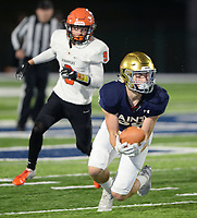 NWA Democrat-Gazette/ANDY SHUPE<br /> Shiloh Christian receiver Beau Cason (right) makes a catch Friday, Nov. 29, 2019, in front of Nashville defensive back Will Pope during the first half of play at Champions Stadium in Springdale. Visit nwadg.com/photos to see more photographs from the game.