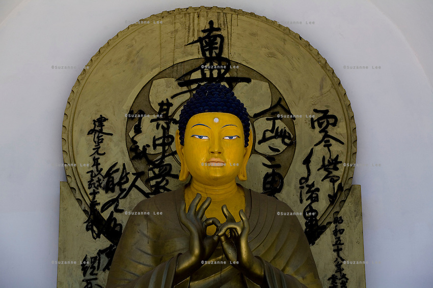 A golden sitting buddha, as seen on 31st May 2009, adorns the second level of Shanti Stupa, the latest addition to skyline of Leh town, Ladakh, Jammu & Kashmir, India. Shanti Stupa was built by the Japanese and sits atop a 100m high hill, accessible climbing by 566 steps.  Photo by Suzanne Lee
