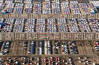 """KFZ Logistik in Bremerhaven: EUROPA, DEUTSCHLAND, NIEDERSACHSEN, BREMERHAVEN  (EUROPE, GERMANY), 14.01.2012: Die aus der 1877 gegruendeten Bremer Lagerhaus Gesellschaft AG entstandene BLG Logistics Group ist heute mit 6.800 Mitarbeitern der europaeische Branchenfuehrer in der Kfz-Logistik. Das Autoterminal der BLG verfuegt ueber eine Gesamtflaeche von drei Millionen Quadratmetern und hat Platz für 120.000 Fahrzeuge. Der Gesamtwert der Fahrzeuge belaeuft sich bei voller Auslastung auf ca. 3,6 Milliarden Euro. Mit einem Gesamtumschlag von ueber zwei Millionen Fahrzeugen 2007  ist Bremerhaven der fuehrende Auto-Umschlagplatz in Europa. Die meisten der für den deutschen Markt bestimmten Import-Fahrzeuge gelangen ueber Bremerhaven nach Deutschland..Neben den Automobilen werden rund eine Million Tonnen sogenannter High & Heavy-Gueter sowie Stueckgueter und Schwergueter bis 200 Tonnen Gewicht im Ro/Ro-Umschlag bewegt. Bei den """"High & Heavy""""-Guetern handelt es sich um Baumaschinen, Bagger, Kettenfahrzeuge, Autokrane, landwirtschaftliche Geraete, Traktoren, Maehdrescher und andere Erntemaschinen, Lkw, Zugmaschinen und auch Lokomotiven. Der ICE-Testzug für Amtrak in den USA sowie der nach China gelieferte Transrapid wurden ueber Bremerhaven verschifft..Luftbilder, Luftfoto, Luftfotos, Luftphoto, Luftphotos, menschenleer, Motors, Neuwagen, Neuwagenparkplatz, niemand, oben, PKW, PKWs, Parkhaus, Parkpalette, Tag, Tage, Tageslicht, tagsueber, tagsueber, Vogelperspektive, Vogelperspektiven, von, Wagen,"""