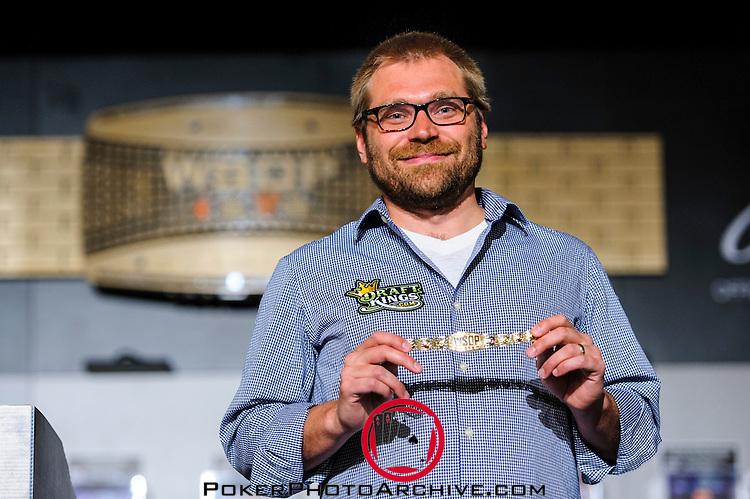 Matt Kalish, CEO of Draft Kings displays the gold bracelet for Event 55