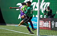 Portland, OR - Saturday April 15, 2017: Jasmyne Spencer, Adrianna Franch during a regular season National Women's Soccer League (NWSL) match between the Portland Thorns FC and the Orlando Pride at Providence Park.
