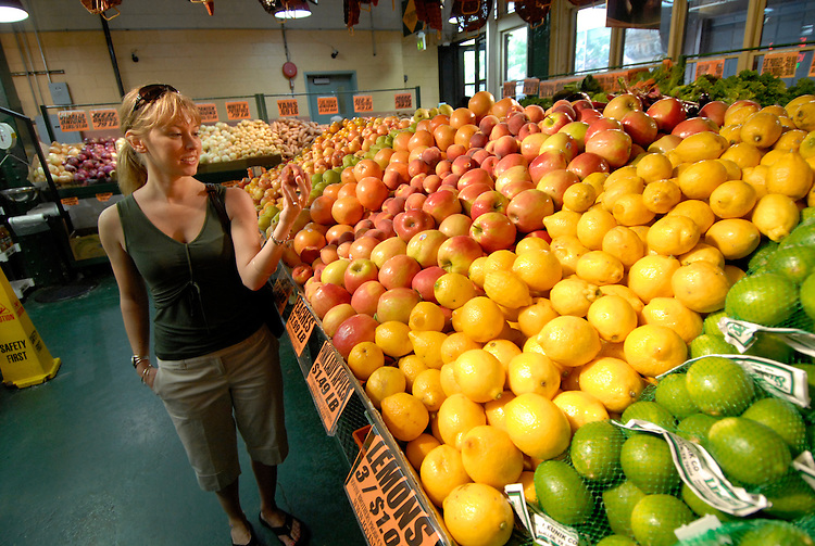 Reading Terminal Market, woman buying produce, mod rel..Philadelphia, Pennsylvania, PA USA.  Photo copyright Lee Foster, 510-549-2202, lee@fostertravel.com, www.fostertravel.com.  Photo 227-30538.