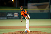 AZL Giants relief pitcher Camilo Doval (17) looks to his catcher for the sign against the AZL Athletics on August 5, 2017 at Scottsdale Stadium in Scottsdale, Arizona. AZL Athletics defeated the AZL Giants 2-1. (Zachary Lucy/Four Seam Images)