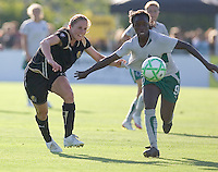 Rachel Buehler (left) and Eniola Aluko (9) chase the ball down the field. St. Louis Athletica defeated FC Gold Pride 1-0 at Buck Shaw Stadium in Santa Clara, California on July 5, 2009.