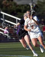 Boston College midfielder Hannah Alley (8) on the attack as University at Albany attacker Kathleen Lennon (23) defends. University at Albany defeated Boston College, 11-10, at Newton Campus Field, on March 30, 2011.