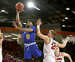 VERMILLION, SD - JANUARY 24: Brandon Key #0 from South Dakota State University lays the ball up past Tyler Peterson #22 from the University of South Dakota during their game Wednesday night at the Sanford Coyote Sports Center in Vermillion, SD. (Photo by Dave Eggen/Inertia)