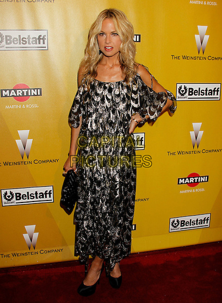 RACHEL ZOE.Weinstein Company Post Golden Globe Party held at Bar210 & Plush Ultra Lounge at the Beverly Hilton Hotel, Beverly Hills, California, USA..January 17th, 2009.globes full length black gold pattern print dress off the shoulder metallic cut out away bag purse platform shoes hand on hip.CAP/ADM/MJ.©Michael Jade/Admedia/Capital Pictures