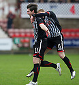 Pars' Ross Forbes (11) celebrates with Andrew Geggan (6) after he scores their first goal.