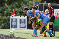 Seattle, WA - Sunday, May 22, 2016: Seattle Reign FC forward Merritt Mathias (9) fights to stay on her feet while battling Chicago Red Stars defender Arin Gilliland (3) for the ball during a regular season National Women's Soccer League (NWSL) match at Memorial Stadium. Chicago Red Stars won 2-1.