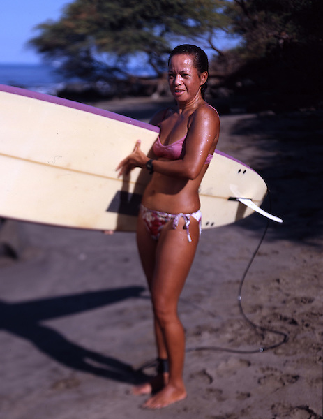 Surfer Shari Nobriga, 46, on a beach near Lahaina, Maui. Photo by Kevin J. Miyazaki/Redux
