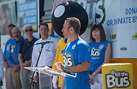 NWA Democrat-Gazette/BEN GOFF @NWABENGOFF<br /> Josh Saffran, director of sales at BIC in Bentonville, speaks Friday, Aug. 3, 2018, during a press event at the United Way of Northwest Arkansas Fill the Bus drop-off location at the Walmart Supercenter on Pleasant Crossing Boulevard in Rogers. Volunteers are manning busses at ten Walmart Supercenter locations in Northwest Arkansas and Pineville, Mo. from 9:00 a.m. to 3:30 p.m. Friday and Saturday to sort donated school supplies. The donations will go directly to the district the Walmart location is in. Over the past ten years, the annual drive has helped more than 35,000 students in 12 school districts get the supplies they need to start the school year.