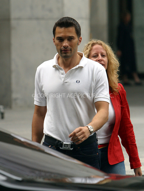 French actor Olivier Martinez spotted in Manhattan with his publicist. Martinez is in town promoting his latest action flick, 'S.W.A.T.' while his girlfriend Aussie pop princess Kylie Minogue is busy filming her new music video on French Rivera. New York, August 5, 2003. Please byline: NY Photo Press.   ..*PAY-PER-USE*      ....NY Photo Press:  ..phone (646) 267-6913;   ..e-mail: info@nyphotopress.com