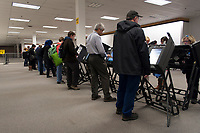 Voters fill out precinct voter's cards at a Columbus, Ohio, early voting center on the first day of early voting in the state.