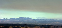 Oct 13, 2004 - Over Northern California, California, USA - Smoke from the Napa and Yolo County fires looms over Mount Diablo  on Wednesday Oct 13, 2004. This picture was made looking toward Mount  Diablo from the Livermore Valley of California..(Credit Image: © Alan Greth)