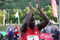 Tuesday 15th July 2014<br /> Pictured: Christian Malcolm<br /> RE: Welsh sprinter Christian Malcolm, claps his hands above his head towards the supporting spectators after winning the 4x100m relay at the Welsh Athletics International in the Cardiff International Sports Stadium, South Wales, UK. His last race on home soil.