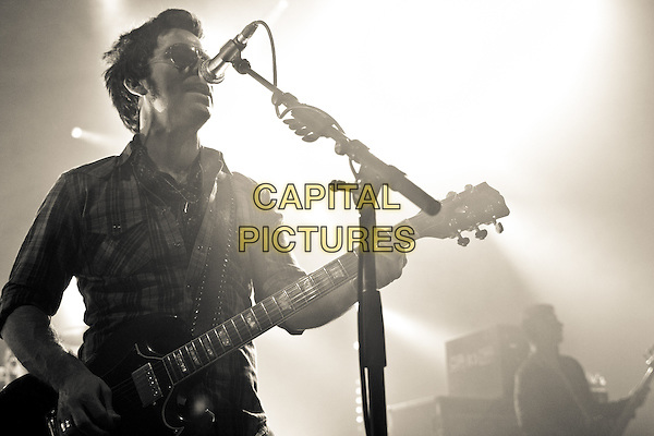 Kelly Jones of The Stereophonics play the Cambridge Corn Exchange, Cambridge, England..July 25th 2012.on stage in concert live gig performance performing music half length singing guitar checked shirt sunglasses shades .CAP/PP/MM.Mike Mustard/PP/Capital Pictures.