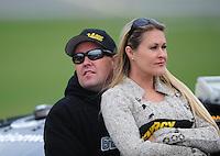 Oct. 3, 2009; Kansas City, KS, USA; NASCAR Nationwide Series driver Brendon Gaughan with wife Tatum Gaughan during qualifying for the Kansas Lottery 300 at Kansas Speedway. Mandatory Credit: Mark J. Rebilas-