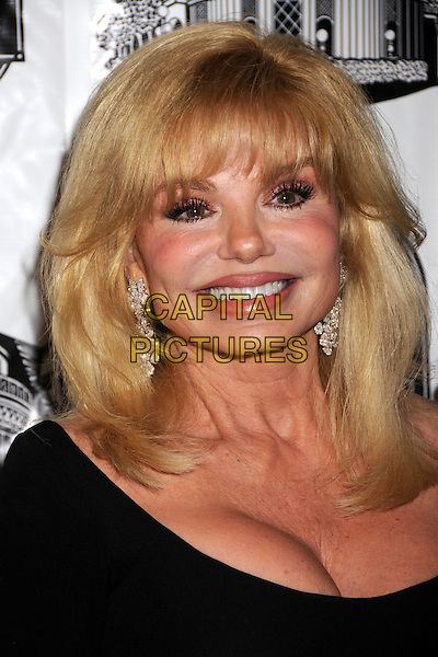 LONI ANDERSON .40th Annual Academy of Magical Arts Awards at the Beverly Hilton Hotel, Beverly Hills, California, USA, .5 April 2008 .portrait headshot earrings black cleavage.CAP/ADM/BP.©Byron Purvis/Admedia/Capital PIctures