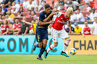 Landover, MD - July 23, 2019: Arsenal Mesut Ozil (10) keeps Real Madrid Raphael Varane (5) away from the ball during the match between Arsenal and Real Madrid at FedEx Field in Landover, MD.   (Photo by Elliott Brown/Media Images International)