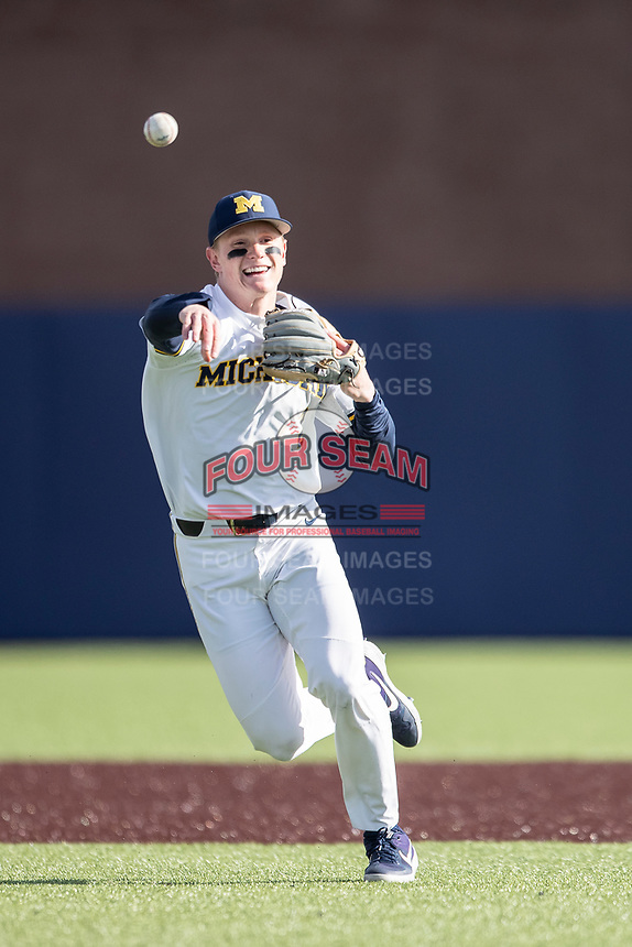 Michigan Wolverines shortstop Jack Blomgren (2) makes a throw to first base against the Rutgers Scarlet Knights on April 26, 2019 in the NCAA baseball game at Ray Fisher Stadium in Ann Arbor, Michigan. Michigan defeated Rutgers 8-3. (Andrew Woolley/Four Seam Images)