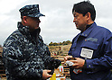 OSHIMA, Japan (April 4, 2011) Rear Adm. Jeffrey S. Jones speaks with a resident of Oshima, to discuss the progress of disaster relief operations. Marines and Sailors assigned to the 31st Marine Expeditionary Unit (31st MEU) are on Oshima Island to help clear a harbor and assist with cleaning debris from roads and a local school in support of Operation Tomodachi. (Photo by U.S. Navy/AFLO) [0006]
