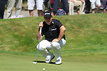 Shane Lowry lines up his putt on the 5th green during Round 3 of the BMW PGA Championship at  Wentworth, Surrey, England, 22nd May 2010...Photo Golffile/Eoin Clarke.(Photo credit should read Eoin Clarke www.golffile.ie)....This Picture has been sent you under the condtions enclosed by:.Newsfile Ltd..The Studio,.Millmount Abbey,.Drogheda,.Co Meath..Ireland..Tel: +353(0)41-9871240.Fax: +353(0)41-9871260.GSM: +353(0)86-2500958.email: pictures@newsfile.ie.www.newsfile.ie.