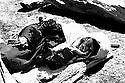 Iran 1991 Old woman sleeping on the ground in the camp of Sardacht  Iran 1991 Une vieille femme endormie a meme le sol apres son arrivee au camp de refugiés de Sardacht
