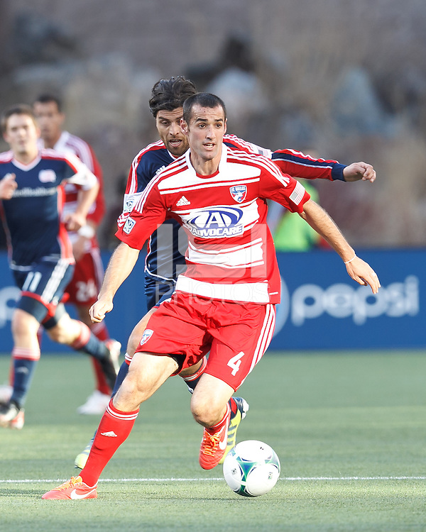 FC Dallas midfielder Andrew Jacobson (4) looks to pass..  In a Major League Soccer (MLS) match, FC Dallas (red) defeated the New England Revolution (blue), 1-0, at Gillette Stadium on March 30, 2013.