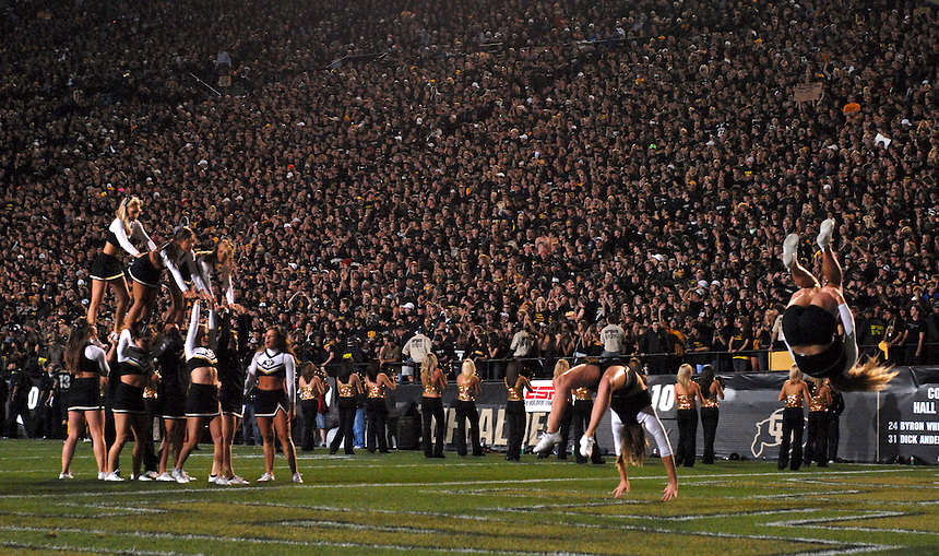 18 September 08: Colorado cheerleaders perform during a break in the action of a game against West Virginia. The Colorado Buffaloes defeated the West Virginia Mountaineers 17-14 in overtime at Folsom Field in Boulder, Colorado. For Editorial Use Only.