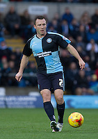 Garry Thompson of Wycombe Wanderers plays a pass during the Sky Bet League 2 match between Wycombe Wanderers and Portsmouth at Adams Park, High Wycombe, England on 28 November 2015. Photo by Andy Rowland.