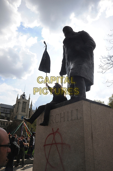 DEMONSTRATORS.in Parliament Square for May Day anarchist protest..1st May 2010.gv general view atmosphere  churchill sitting graffiti writing flag. CAP/IA.©Ian Allis/Capital Pictures.
