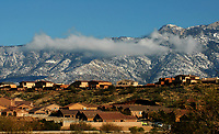 Saturday morning northwest side residents enjoyed the frosted over Catalina Mountains. Above clouds drape the Mt Lemmon part of the range above the Eagle Crest Subdivision in Catalina, Az.