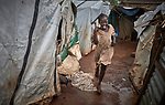 A girl runs in the rain through a displaced persons camp at the Holy Family Catholic Church in Wau, South Sudan. The church has provided food, shelter material, and health care, and the presence of clergy and religious has fostered a sense of relative safety for the families who first occupied the church grounds when fighting enveloped the city in 2016.