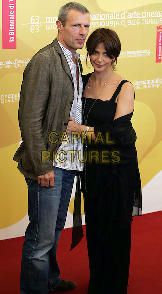 "LAMBERT WILSON & LAURA MORANTE.""Private Fears In Public Places"" (Coeurs) photocall on the fourth day of the 63rd Venice International Film Festival, Venice, Italy. .September 2nd, 2006 .Ref: OME/GPA.full length jeans denim trousers top dress grey gray jacket.www.capitalpictures.com .sales@capitalpictures.com .©Omega/Capital Pictures"