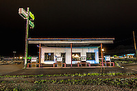 Abandoned gas station at night in Sanderson, TX