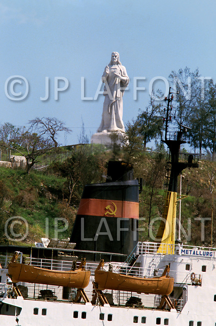 February 22, 1986. Havana, Cuba. A giant statue representation of Christ is a good luck benediction for boats arriving and departing from the passage Boca Del Torro to Havana Harbor.