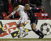 Billy Cortes #7 of the University of Maryland keeps the ball away from Mackenzie Arment #21 of Penn State during an NCAA 3rd. round match at Ludwig Field, University of Maryland, College Park, Maryland on November 28 2010.Maryland won 1-0.