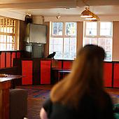 """Portsmouth, Great Britain, April 2010:.Black cat watching guests at the  """"The Portsdown"""" community pub in Paulsgrove near Portsmouth. Almost all guests here are local people who know each other well and meet here for a chat..(Photo by Piotr Malecki / Napo Images)..Portsmouth, Wielka Brytania, Kwiecien 2010:.Czarny kot przyglada sie gosciom w pubie """"The Portsdown"""". .Prawie wszyscy goscie tutaj to stali bywalcy i mieszkancy okolicznych domow, ktorzy znaja sie dobrze i spotykaja tu codziennie..Fot: Piotr Malecki / Napo Images"""