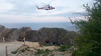 BNPS.co.uk (01202 558833)<br /> Pic: KimmeridgeCRT/BNPS<br /> <br /> This is the dramatic moment a coastguard helicopter crew showed 'fantastic skills' to pluck three foolhardy teenagers from a 200ft cliff.<br /> <br /> The three male youths had climbed up Stair Hole at Lulworth Cove, Dorset, but were unable to get past an overhang near the top and became stuck.<br /> <br /> Onlookers at the beauty spot realised their perilous state and raised the alarm at about 8pm last night (Tues).<br /> <br /> The coastguard helicopter crew spent 30 minutes hovering above the cliff while a winchman was lowered down to rescue the trio one-by-one.